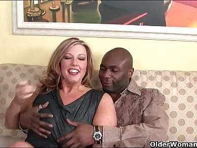 Milf lets black cock explode on her face