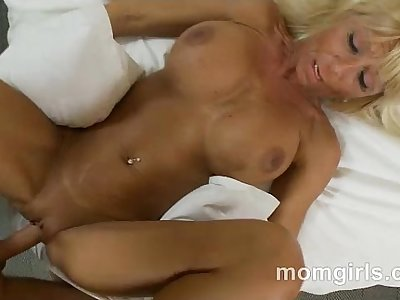 Busty blonde milf in pink top sucks and fucks dick